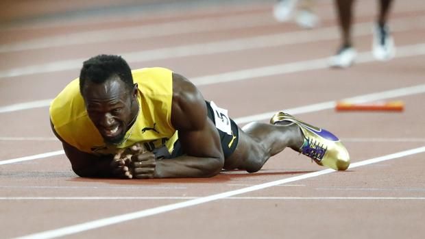 usain bolt ultima carrera lesion londres mundial atletismo video