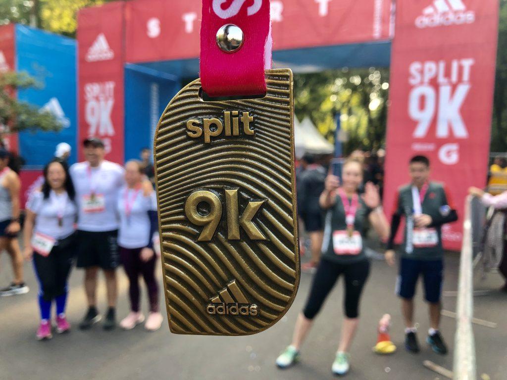 medalla resultados split adidas 9K
